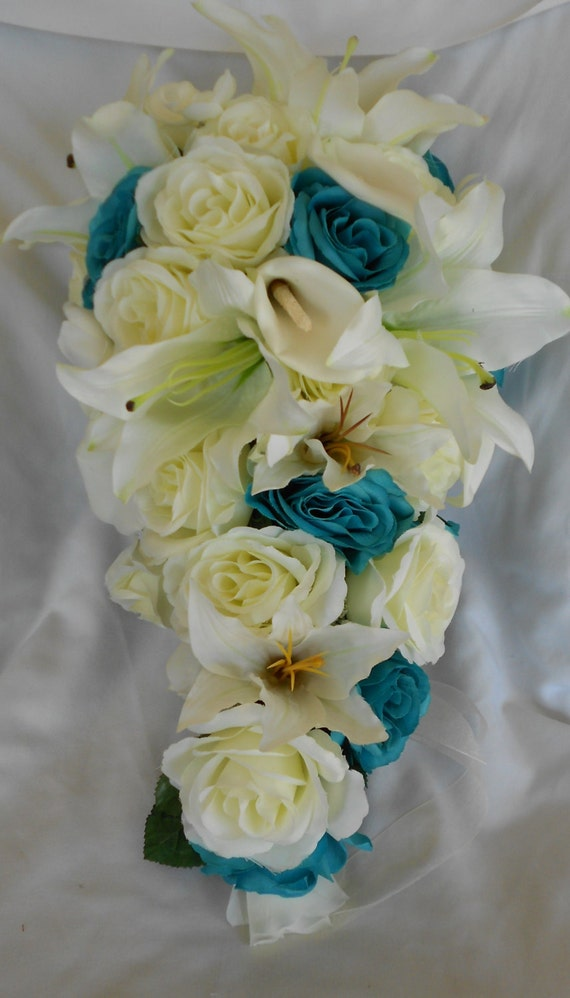 Turquoise cascade bridal bouquet lilies and roses