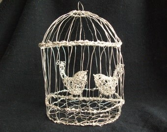 Birds in a cage wire sculpture
