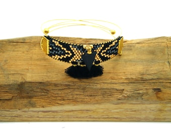 Bohemian cuff black pompoms and wood
