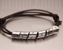 Secret Message bracelet, spiralled aluminium personalised motif on adjustable knotted leather cord
