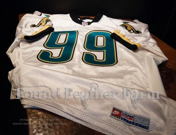 Original Logo Authentic NFL Players Jersey signed by Jacksonville Jaguar #99 Defensive End Collectors Item