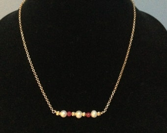 Pearl and Ruby necklace in 14 kt. Gold fill