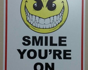 Smile your camera sign