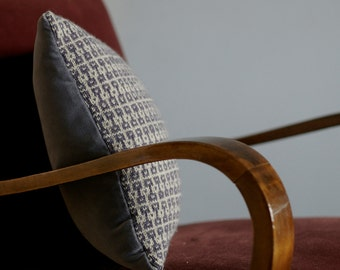 Geometric hand knit pillow