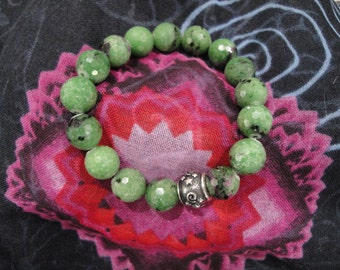 Zoisite with Ruby stretch bracelet.  Joyful engagement with life
