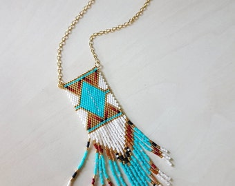 Native American style beaded pendant on gold chain