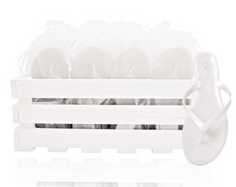 30 pairs of pearl finish white flip flops presented in a beautiful crate