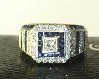 White gold ring with 0.84ct diamonds and 0.54ct sapphires