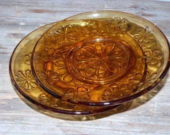 2 ocher Vereco plates with flowers.