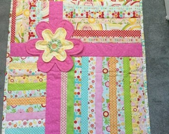 "Baby quilt that looks like a ""present""!!! The bow has a multi dementional flower in the center."