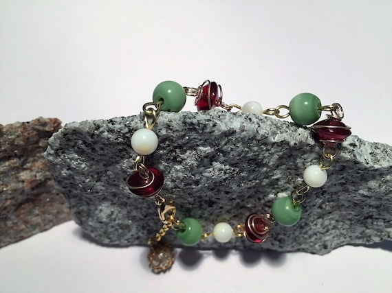 Christmas Bracelet with Green and White Beads and Gold Wire-wrapped Red Beads. Gold Foil Wrapped White Charm. Gold Links. Holiday.