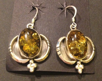 Handmade dangling sterling silver earrings with amber inset stones