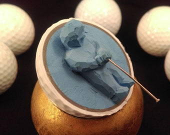 Golfer, carved golf ball