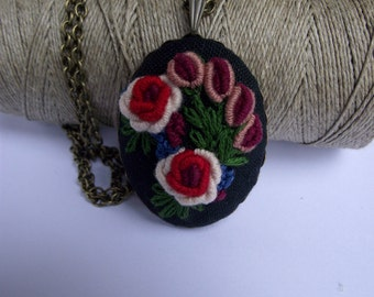 Hand embroidered pendant