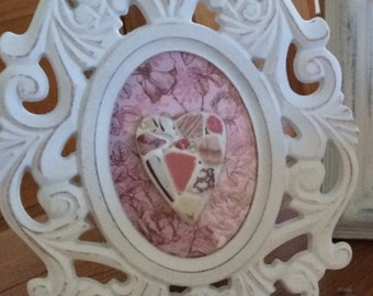 pink multi sea pottery framed picture