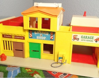 Vintage fisher price village 1970's collectable toys includes bridge and cars
