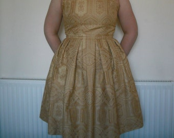 Gorgeous ornate gold dress sample, half lined. Size 16 (UK)