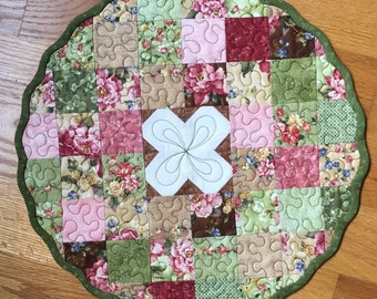 Small circular floral table topper