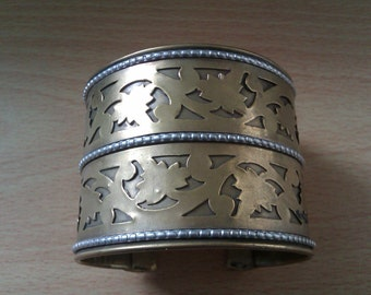 vintage brass and silver coloured cut out bandle