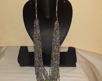 A multistrand silver tone and beaded necklace, very boho chic.