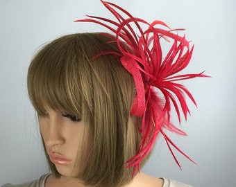 Red Fascinator on comb with feathers. Weddings, formal events, races, brides, occasions, parties