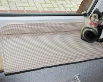Cuddly cat cushions, window cushions,