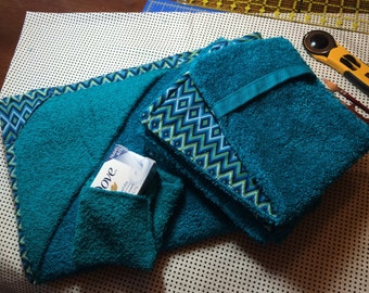 Newborn towel with two lined burp cloths and one pocket wash cloth