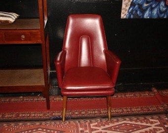"""1950's Mid Century modern chair with original vinyl upholstery and attractive wood base with brass details .  Size: 25"""" w x 33"""" l x 39"""" h"""