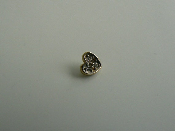 14 k gold dermal attachment with cubic zirconia