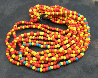 Vintage mass of Sherpa beads, multi strand red and yellow wound glass beads