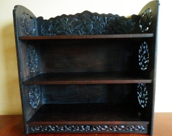 19th Century hardwood wall mounted open shelf with carved decoration