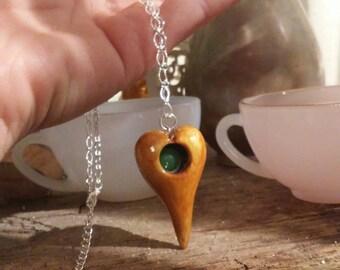 Hand carved myrtle wood heart necklace