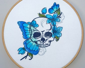Skull butterflies and flowers embroidered hoop art painted vanitas turquoise blue blossom wings modern tattoo embroidery personalised gift