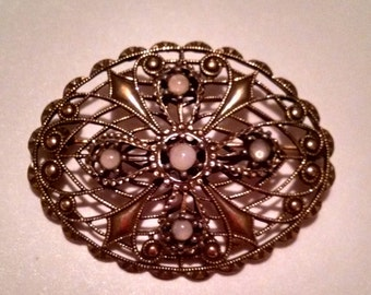 Ornate Vintage Gold Tone Brooch with Cross Detail and Opaque Stones