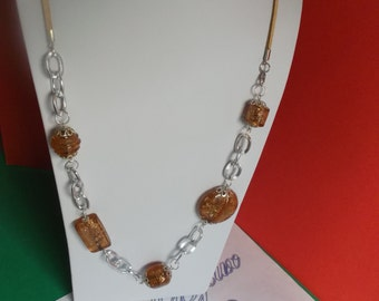 Long necklace with glass beads with silver foil