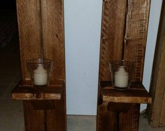 Jar candle wall sconces. Candles in picture are votive candles to show you the size but will sit a jar candle nicely.
