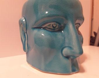 Empty headed...blue ceramic planter