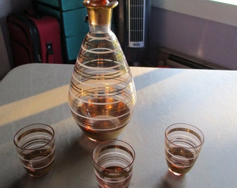 1960's gold and white glass decanter and shot glasses