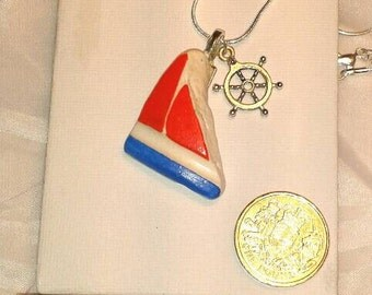 Hand painted tumbled pottery necklace with added charm