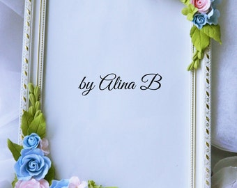 Photo frame with flowers made of polymer clay