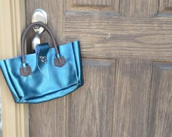 Teal and brown leather handbag.