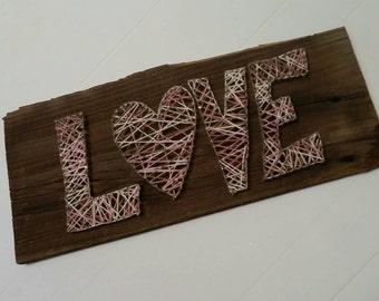 Handmade nail yarn/string art on reclaimed Barnwood,  LOVE