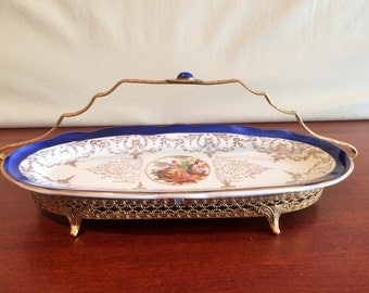 China Celery Dish with 22kt Gold Painted trim on a Brass Filigree Stand