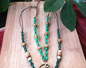 Green macrame chains OM sign