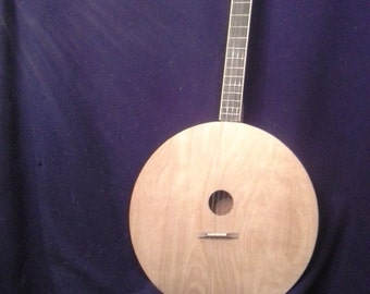 Four stringed round guitar