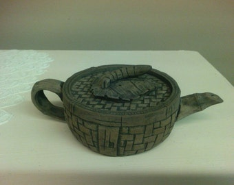 Carved Sandstone Caterpillar Teapot.