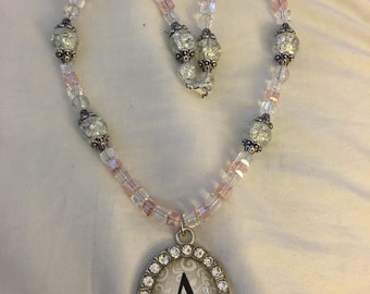 A pendant with crystal beads