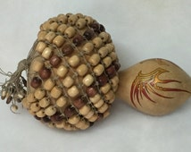 Skekere Fire is a home grown, hand painted Gourd crafted into a lovely sounding musical Instrument