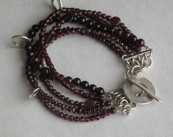 5 strand Garnet and silver bracelet
