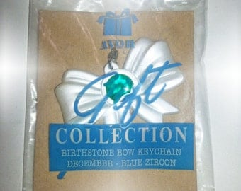 Vintage AVON Gift Collection - Bow Key Chain - December Birthstone - Blue Zircon Color birthstone set on White Pearl-like finish bow